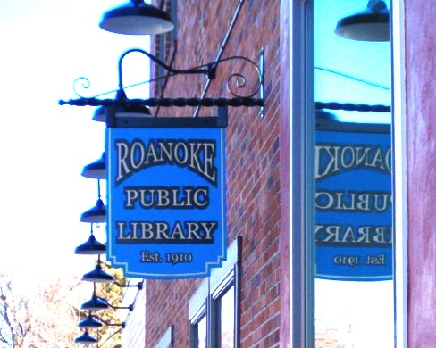 A photo of Sign hanging outside the library
