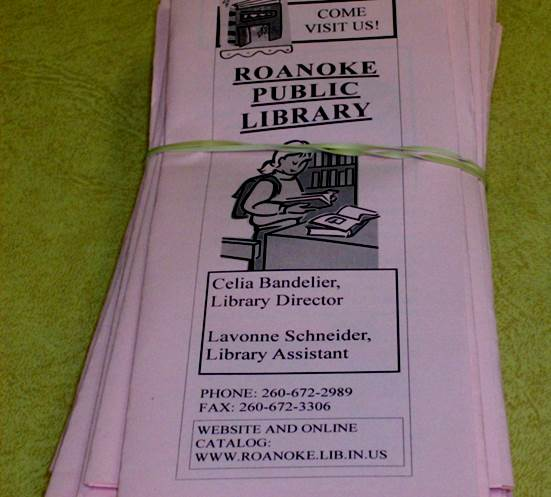 A photo of Tri-fold Roanoke Public Library brochures featuring all the facts about the library.
